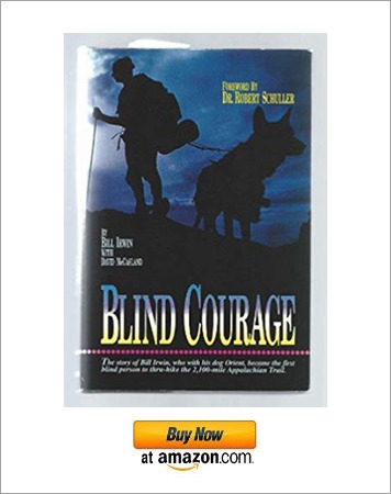 The cover photo of the book Blind Courage having a man and his dog hiking a trail